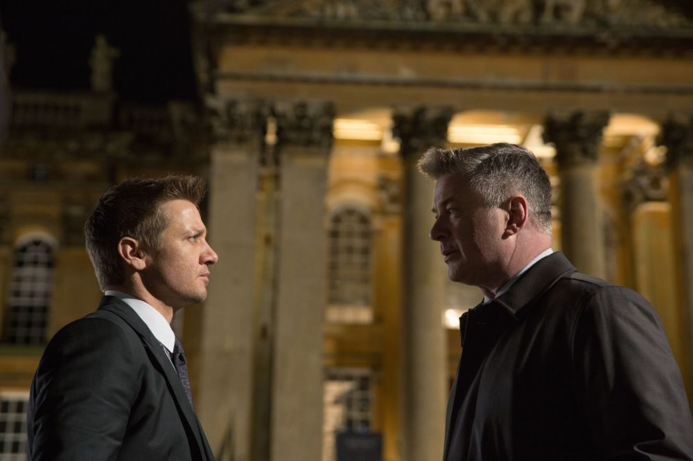 Left to right: Jeremy Renner plays William Brandt and Alec Baldwin plays Alan Hunley in Mission: Impossible - Rogue Nation from Paramount Pictures and Skydance Productions.
